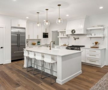 an all-white kitchen cabinetry design with wood floor and white walls   Rockingham Kitchen Renovations