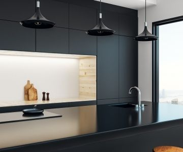 a contemporary kitchen design with a black granite benchtop   Rockingham Kitchen Renovations