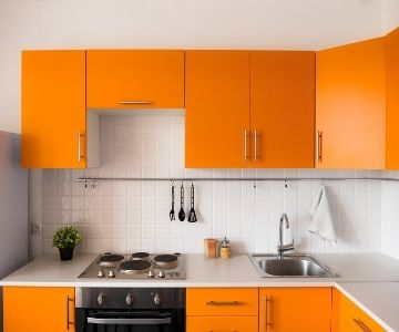 a set of orange cabinets in a small kitchen   Rockingham Kitchen Renovations